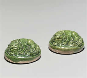 AN UNUSUAL PAIR OF GREEN-GLAZE