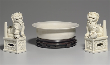 A PAIR OF BLANC-DE-CHINE BUDDH