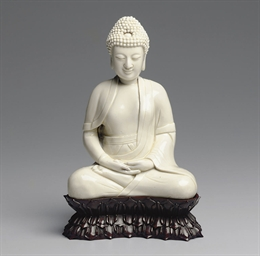 A BLANC-DE-CHINE FIGURE OF THE