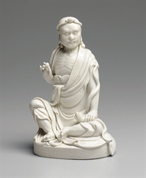 A BLANC-DE-CHINE FIGURE OF AN