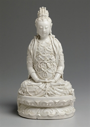 A BLANC-DE-CHINE FIGURE OF A B