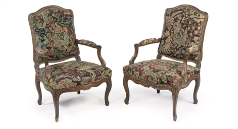 A pair of Louis XV walnut faut