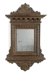 An Italian walnut mirror