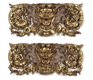 A pair of gilt and polychrome