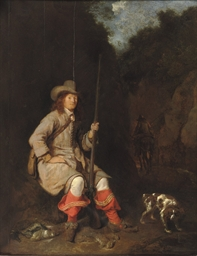 A huntsman and his hound in a