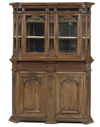A FLEMISH OAK DISPLAY CABINET