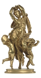 A FRENCH GILT BRONZE GROUP OF A CLASSICAL MAIDEN DANCING WITH TWO PUTTI