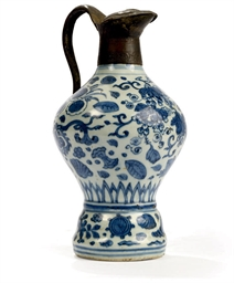 A MING BLUE-AND-WHITE EWER CHI