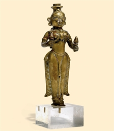 A RAJASTHANI BRASS FIGURE OF S