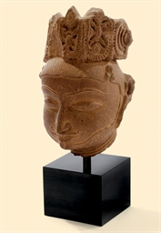 AN INDIAN RED SANDSTONE HEAD O