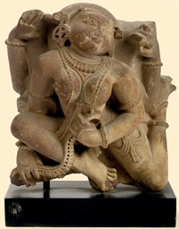 AN INDIAN SANDSTONE FIGURE OF