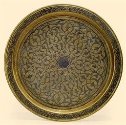 A CAIROWARE DISH EGYPT OR SYRI