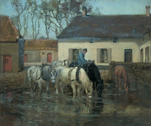 Horses drinking in front of a