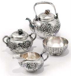 A JAPANESE SILVER THREE-PIECE