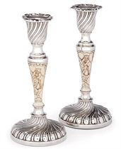 A PAIR OF LATE VICTORIAN SILVER AND IVORY DWARF CANDLESTICKS