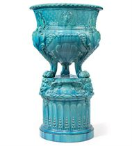 A BURMANTOFTS TURQUOISE-GLAZED JARDINIERE AND STAND