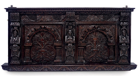 AN ENGLISH CARVED OAK OVERMANT