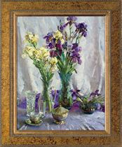 White and purple irises in glass vases