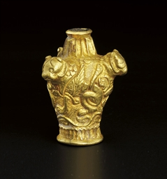A CAST GOLD FINIAL WITH THREE