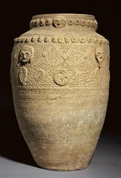 AN INTACT UNGLAZED POTTERY JAR