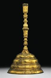 A GILT-COPPER (TOMBAK) CANDLES