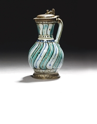 A GILT-COPPER MOUNTED IZNIK PO