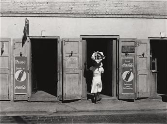 Untitled (Woman in doorway), c