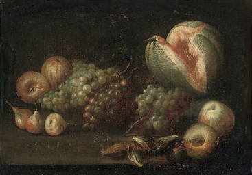 A melon, figs, pears and grape