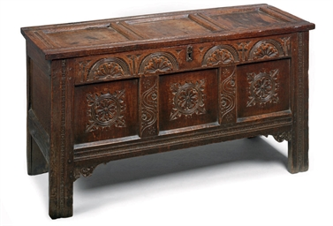 A CHARLES II OAK PANELLED CHES