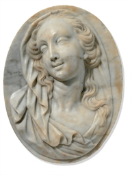 A WHITE MARBLE RELIEF OF A WOM
