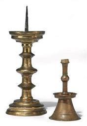 A GERMAN BRASS PRICKET CANDLES