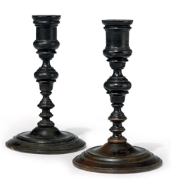A PAIR OF STAINED WOOD CANDLES