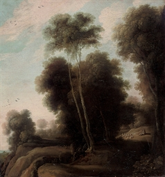 A wooded landscape with a shep