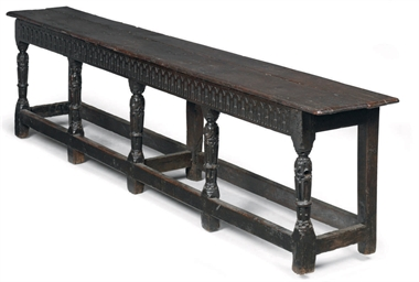 A JAMES I OAK LONG BENCH OR FO