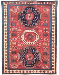 A TRIPLE MEDALLION KAZAK RUG