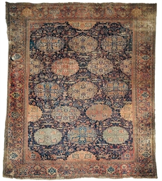 A LARGE FEREGHAN CARPET
