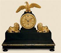 A REGENCY ORMOLU AND BLACK SLATE TIMEPIECE MANTEL CLOCK