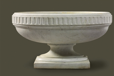 A GREY-VEINED WHITE MARBLE URN