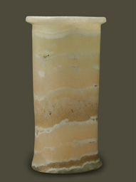 AN EGYPTIAN ALABASTER CYLINDRI