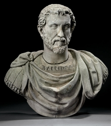 A WHITE MARBLE BUST OF AN EMPE