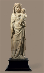 AN ALABASTER-CARVED GROUP OF T