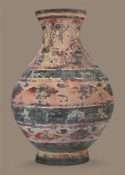 A PAINTED GREY POTTERY JAR, HU