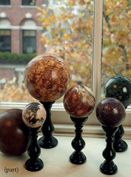 A GROUP OF FIVE MARBLE AND HAR