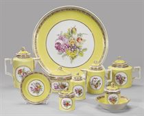 A porcelain yellow ground tea service
