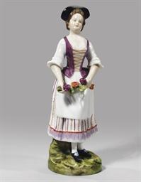 A porcelain figure of a flower