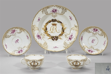 A porcelain plate and two cups