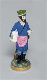 A PORCELAIN FIGURE OF A TEA VE