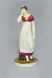 A RARE PORCELAIN FIGURE OF A W