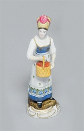 A PORCELAIN FIGURE OF A WOMAN