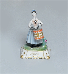 A SMALL PORCELAIN FIGURE OF 'M